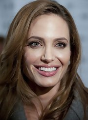 Angelina Jolie added a touch of shiny gloss to her minimal makeup look a the Washington DC premiere of 'In the Land of Blood and Honey.'