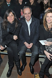 Emmanuelle Alt gravitated towards slouchy black leather boots that were both comfortable and stylish as attended the Lanvin show.