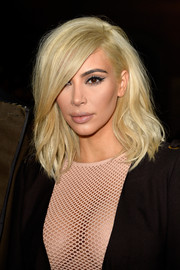 Kim Kardashian wore her newly bleached hair in a messy-chic mid-length bob during the Lanvin fashion show.
