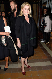 Catherine Deneuve wore a simple yet classy silk scarf and LBD ensemble at the Lanvin fashion show.