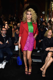 Tori Kelly was sure to stand out in bright, mixed colors - including this purple suede skirt under a lipstick-red jacket.