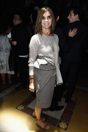 Carine Roitfeld opted for flat brown sandals instead of heels when she attended the Lanvin fashion show.