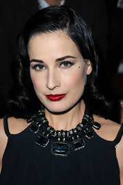 Dita Von Teese attended the Lanvin fall 2012 runway show in Paris wearing deep metallic blue eyeshadow.