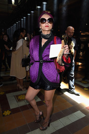 Catherine Baba cut a striking figure at the Lanvin fashion show in a quilted violet jacket teamed with leather shorts.