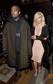 Kanye West finished off his outfit with a pair of brown lace-up boots by Yeezy.