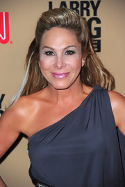 Adrienne Maloof looked hip at the 'Larry King Live' party with her half-up half-down pompadour and gray one-shoulder dress.