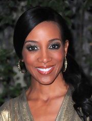 Shaun Robinson added shine to her glittery lamé gown with a pair of gold and pewter hoops embellished with gemstones.