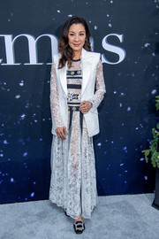 A white blazer with lace sleeves topped off Michelle Yeoh's outfit.