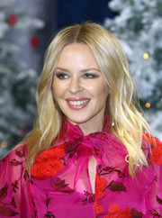 Kylie Minogue wore her hair in a center-parted style with barely-there waves at the UK premiere of 'Last Christmas.'