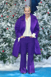 Emma Thompson looked winter-ready in a purple coat and pants combo at the UK premiere of 'Last Christmas.'