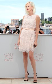 Charlize Theron oozed sweetness in a scalloped pink mini dress by Givenchy at the Cannes photocall for 'The Last Face.'