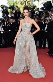 Alessandra Ambrosio sparkled in a Zuhair Murad Couture strapless, beaded jumpsuit with a skirt overlay at the Cannes premiere of 'The Last Face.'
