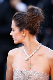 Alessandra Ambrosio styled her hair into a loose high bun for the Cannes premiere of 'The Last Face.'