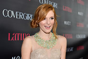 Bella Thorne's floral collar necklace made a major statement in contrast to her nude dress.
