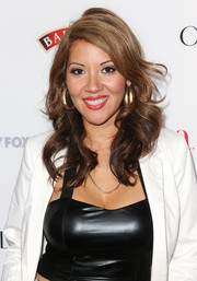 Raquel Cordova was sexily coiffed with sculpted curls when she attended the Hollywood Hot List party.