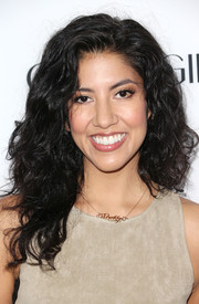 Stephanie Beatriz wore her hair in a high-volume curly style when she attended the Hollywood Hot List party.