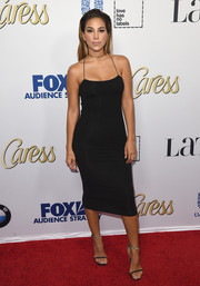 Liz Hernandez steamed up the red carpet in a body-con black cami dress during the Latina Hot List party.