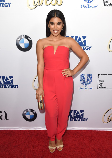 Chrissie Fit chose a strapless red jumpsuit for her Latina Hot List party look.