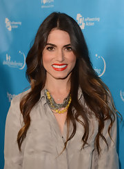 Nikki Reed's lips popped with a red hue with a slight orange undertone while at an event in LA.