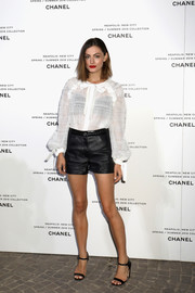 Phoebe Tonkin attended the launch of Lucia Pica's Spring 2018 makeup collection wearing a semi-sheer white blouse by Chanel.