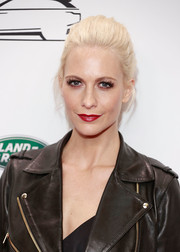 Poppy Delevingne attended the launch of the new Range Rover Velar wearing her hair in a loose ponytail.