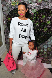 Melanie Brown made an appearance at the Wildfox Loves Coca-Cola collection launch wearing a Nasty Gal x Private Party Rosé All Day sweatshirt.