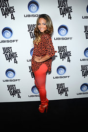 Christina Milian stayed within her outfit's bright red color scheme with these sky-high red platforms.