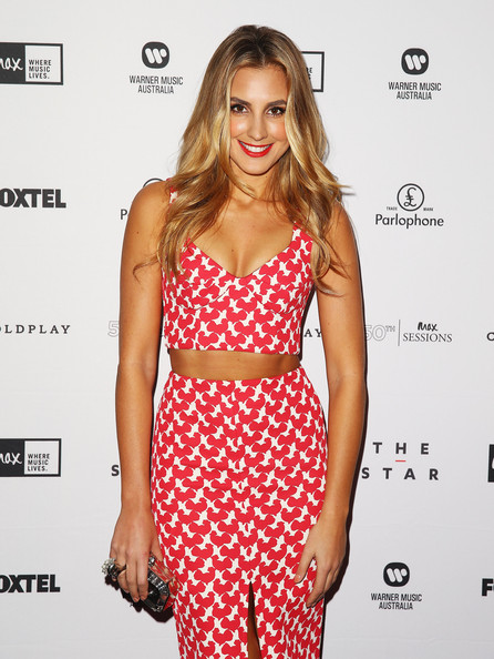 Laura Dundovic Crop Top [clothing,fashion model,dress,shoulder,crop top,hairstyle,fashion,waist,cocktail dress,long hair,laura dundovic,sydney,australia,the star event centre,coldplay,coldplay - arrivals]