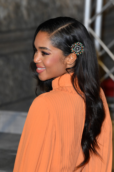 Laura Harrier Long Side Part [hair,hairstyle,orange,hair accessory,beauty,ear,long hair,headpiece,chin,forehead,red carpet arrivals,laura harrier,ee,london,england,royal albert hall,british academy film awards]