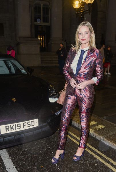 Laura Whitmore Pantsuit [street fashion,pink,clothing,fashion,tights,lady,outerwear,textile,footwear,haute couture,arrivals,joshua kane,laura whitmore,experience,style,mythical creatures,mythical creatures - immersive runway,england,porsche,the royal exchange]