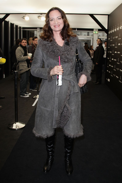 Natalia wears a suede wrap coat with shearing for Fashion Week in Germany.
