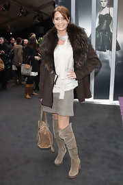Anja dons a suede coat with a large fur collar to Fashion Week in Germany.