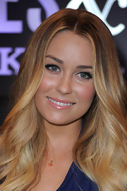 Lauren Conrad keeps her nude lipstick flattering by choosing a color with a hint of pink in it.