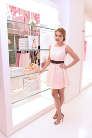 Lauren Conrad paired her cute dress with strappy nude heels.