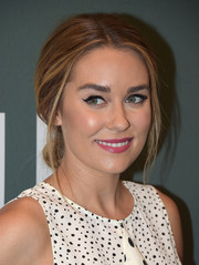 Lauren Conrad polished off her beauty look with a fuchsia lip.