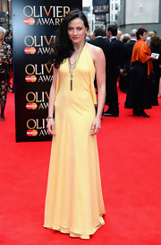 Lara Pulver stuck to a pale yellow column-style halter dress for her red carpet look.