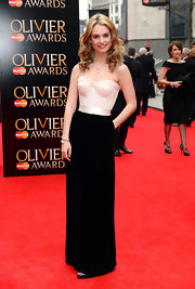 Lily James showed off her figure with this black and white gown, featuring a corset-style top.