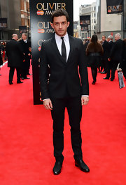 Jonathan Bailey opted for a contemporary notch-lapel suit on the red carpet of the Laurence Olivier Awards.