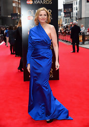 Kim Cattrall showed off some skin with a one-shouldered-dress in a rich royal blue hue.