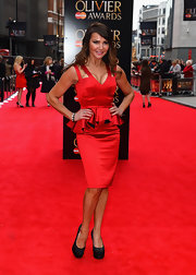 Lizzie Cundy's red peplum dress showed off the star's sexy curves.