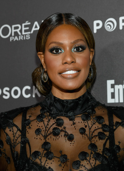 Laverne Cox Chignon [hair,face,eyebrow,hairstyle,lip,beauty,chin,forehead,nose,cheek,nominees,popsockets - arrivals,laverne cox,popsockets,entertainment weekly celebrates screen actors guild award,chateau marmont,california,los angeles,lor\u00e9al paris,cadillac]
