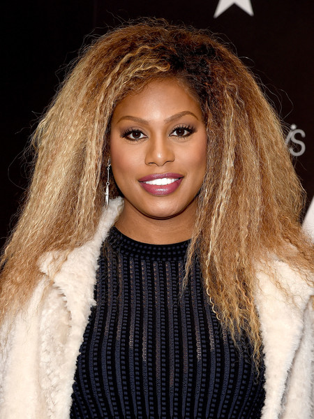 Laverne Cox channeled Tina Turner with this teased hairstyle during her visit to Macy's Herald Square.