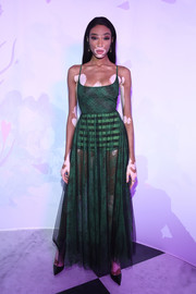 Winnie Harlow rocked a sheer emerald gown by Dior during the label's 'Le Bal Surrealiste' show. The striped hot pants added a playful touch!