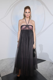 Chiara Ferragni kept it breezy yet glam in this empire-waist halter gown at the 'Le Bal Surrealiste' Dior show.