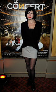 Delphine Chaneac covered her legs with a pair of dotted semi-sheer tights at the 'Le Concert' celebration.