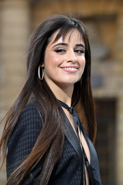 Camila Cabello jazzed up her lobes with a pair of diamond hoops.