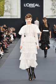Barbara Palvin oozed girly appeal wearing this tiered white lace dress by Giambattista Valli on the Le Defile L'Oreal Paris runway.