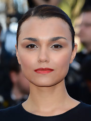 To give her beauty look a bit of a pop, Samantha Barks rocked a deep red lipstick.