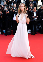 Olga Sorokina chose a flowing gown with a deep V-neck for her soft and pretty red carpet look.