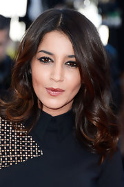 The gorgeous Leila Bekhti was spotted in long curls at Cannes.